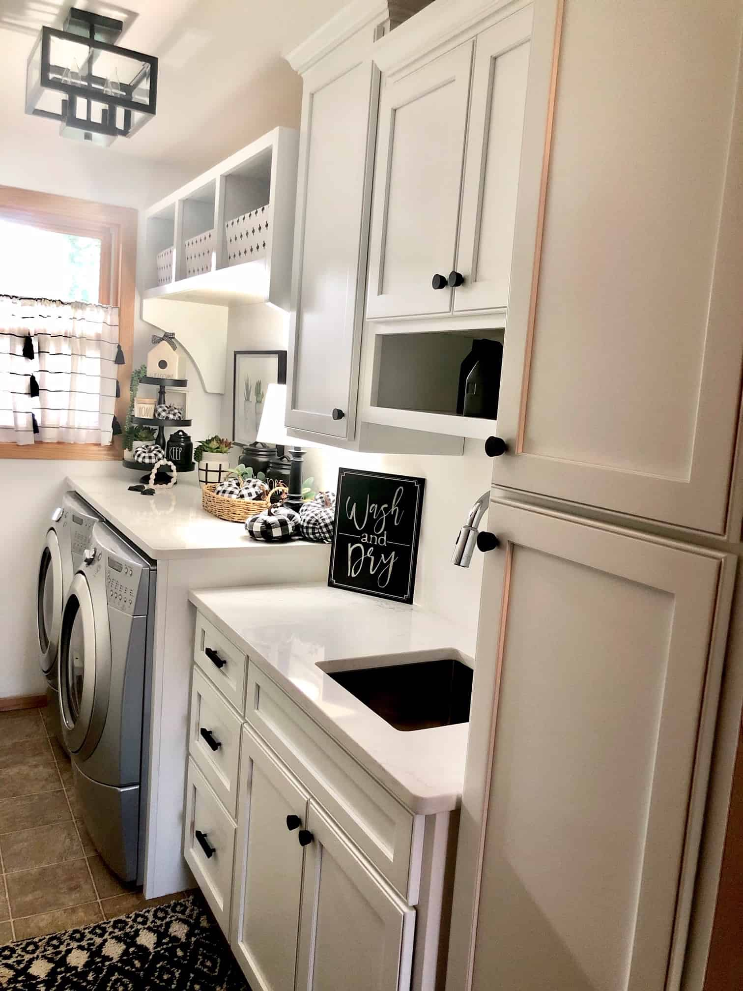 White laundry room in Rae Dunn style