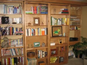 Maple bookcases hide murphy bed
