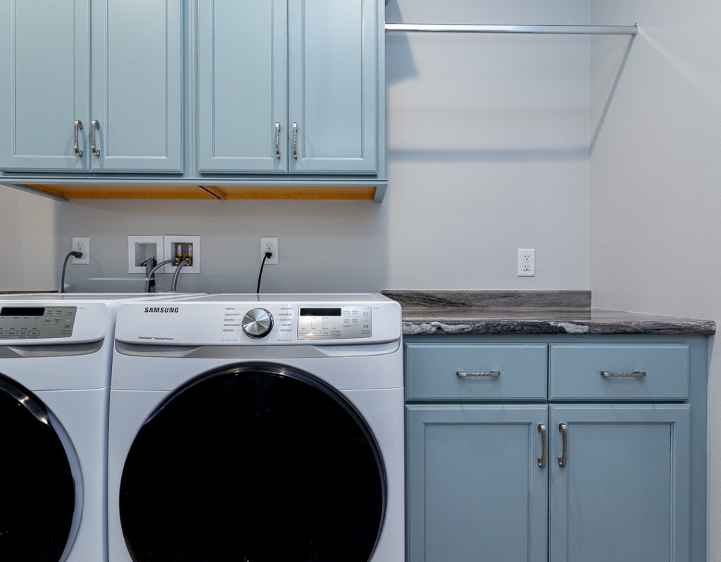 Blue countertops for laundry room storage