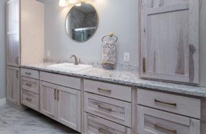 master bathroom maple cabinetry with quartz