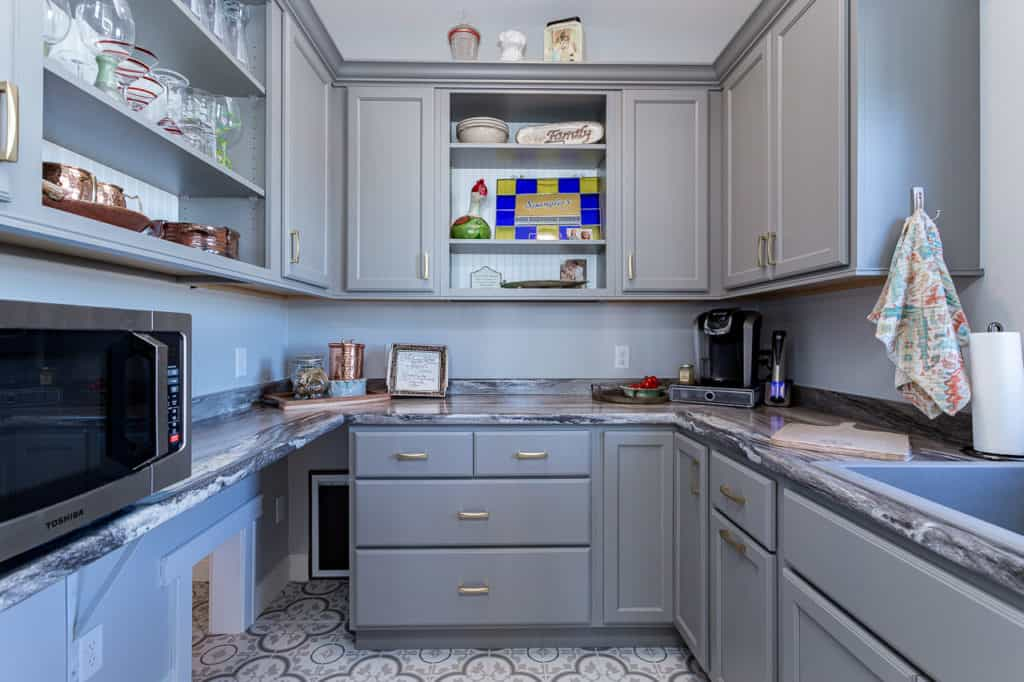 Gray cabinets in walk-in pantry