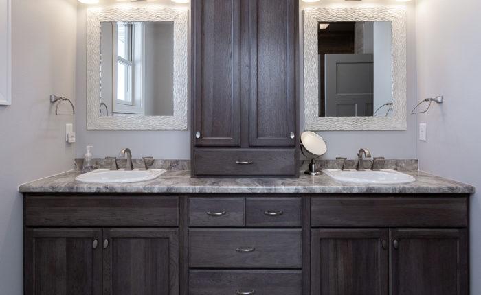 Oak master bathroom with double sinks