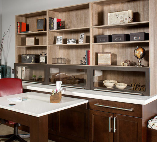 contemporary home office with desk, book cases and credenza