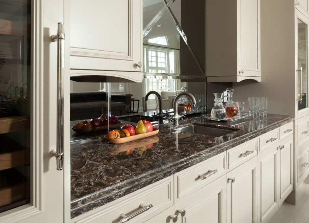 wet bar highlights kitchen with chrome hardware