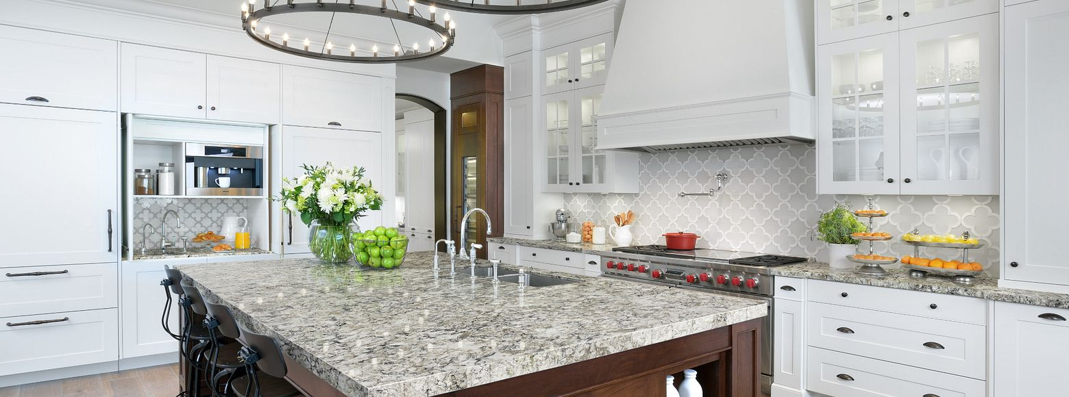 White kitchen cabinets with quartz island